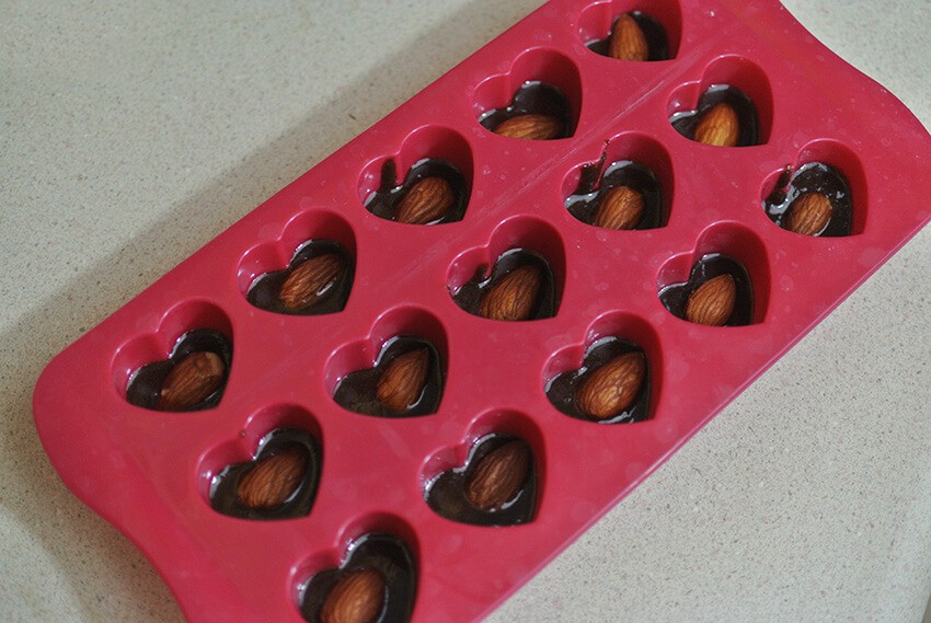 Fill with chocolate and an almond